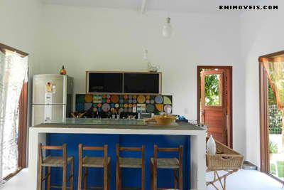 Cozinha integrada na sala com balcão